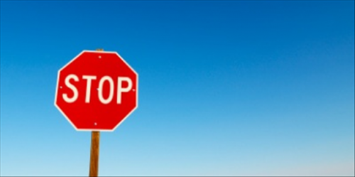 Officer issuing Stop Sign Violation in California